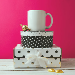 Coffee cup mock up with polka dots boxes and chocolate