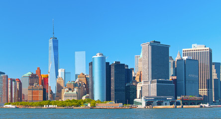 New York City lower Manhattan financial  wall street district buildings skyline on a beautiful summer day with blue sky