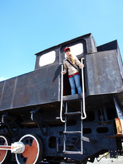 A girl looks from the site of the old steam locomotive