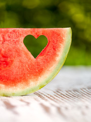slice watermelon with a hole in the shape of heart