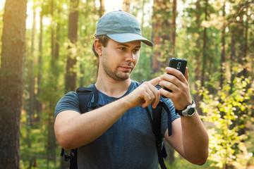Man tourist with smartphone