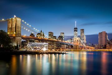 Brooklyn Bridge and the Lower Manhattan skyline at dusk