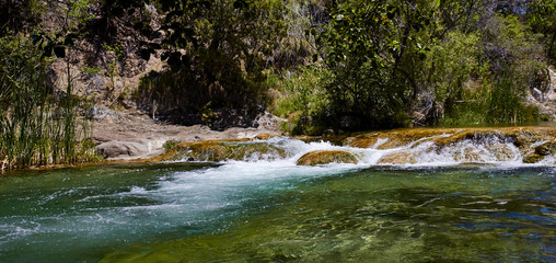 Clear water running over rocks at Fossil Creek, Arizona