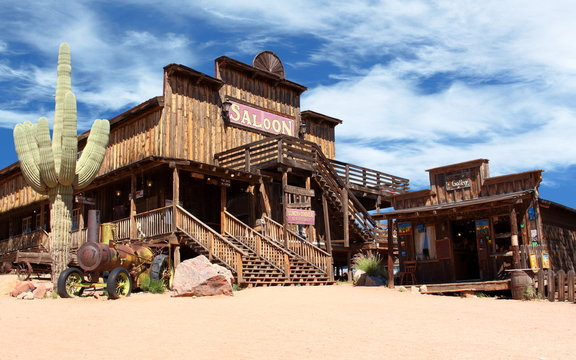 Old Wild West desert cowboy town with cactus and saloon