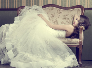 beautiful bride on a retro couch