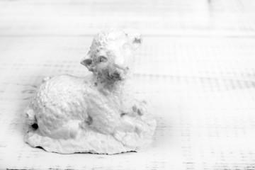 White sheep figure on a white background