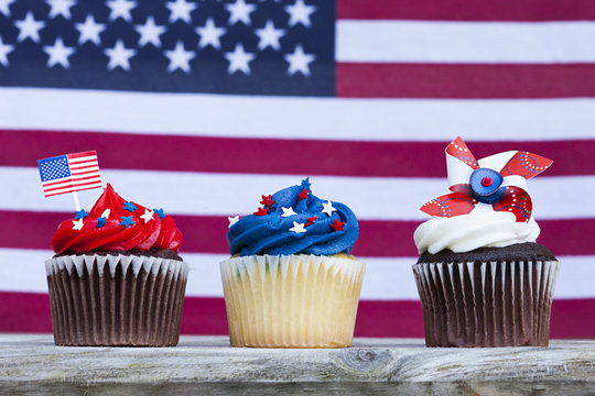 Patriotic holiday 4th of july: cupcakes over American flag