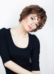 Fashion style photo. Model in black dress.