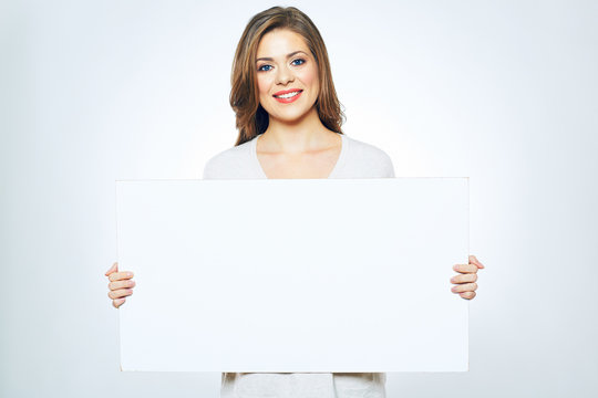 smiling woman holding white  sign board.