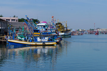 Waterfront marina full of commercial fishing boats in Rayong , Thailand