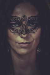 Theater, brunette woman in black mask metal frills