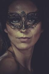 brunette woman in black mask metal frills