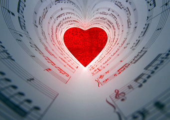 Red heart and sheet music