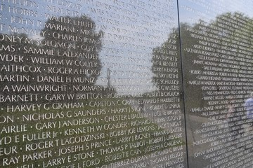 close up view of the Vietnam wall memorial in Washington DC (with the Washington monument seen in the reflection)