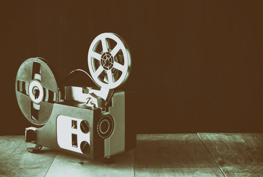 old 8mm Film Projector over wooden table