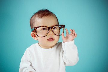Little baby with Glasses, new family and love concept.