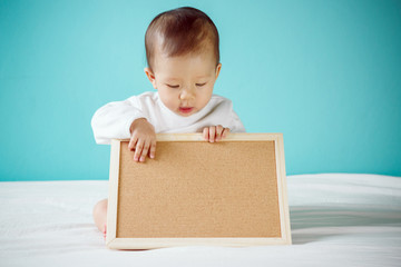 Baby with Blank Board, studio shot