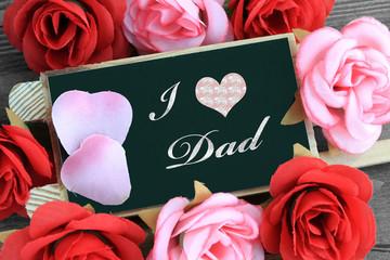 """""""I love dad"""" message written on chalkboard"""