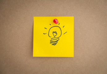 Sticky note with idae bulb on board