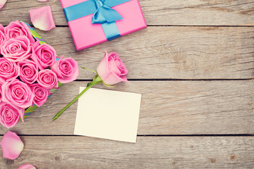 Valentines day greeting card and gift box full of pink roses
