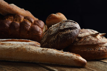 Assortment of fresh bread on a wooden background