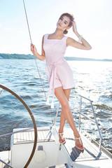 Beautiful sexy brunette girl in dress makeup summer trip yacht