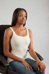 Pretty Black woman sitting in a chiar