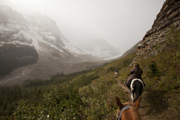 horseback riding through Plain of Six Glaciers Banff during snow