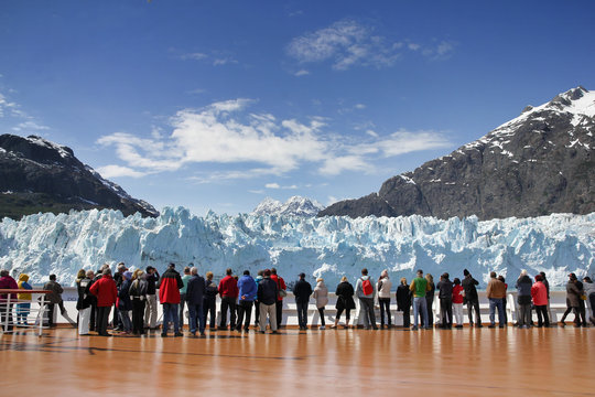 Cruise passengers watching glacier in Alaska