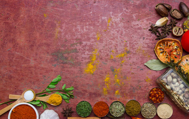 Mixed spices and herbs.Food and cuisine ingredients red backgro