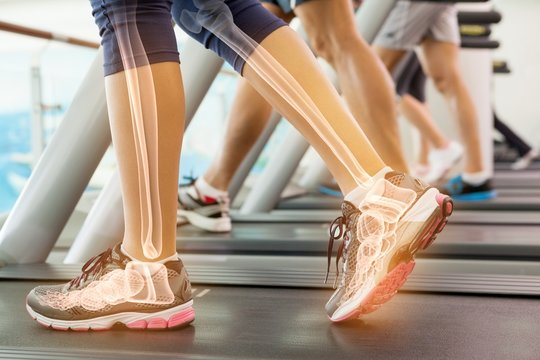 Highlighted ankle of woman on treadmill
