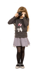 A little girl with photo camera.