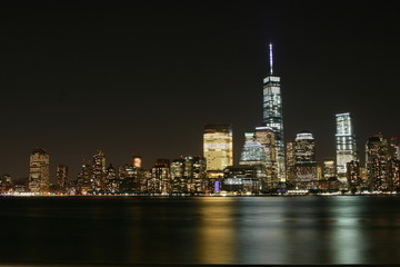 Manhattan night  view with skyscrapers on the right