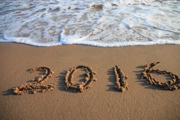 2016 New Year written on the beach