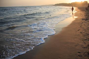 Sea wave over sand beach