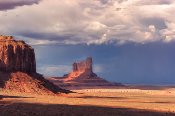 Storm clouds over the Monument Valley at sunset, Arizona