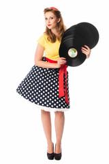 Pinup Girl präsentiert alte Langspielplatten