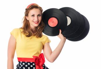 Pinup Mädchen hält Schallplatten als Werbefläche