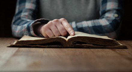Woman hands reading the bible