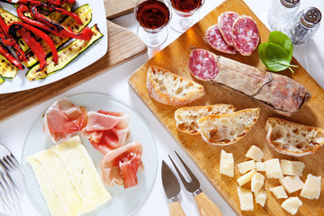 Italian healthy snacks. prosciutto, salami, vegetables grilled p