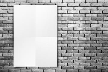 Black White paper poster hanging at grunge brick wall,Template m