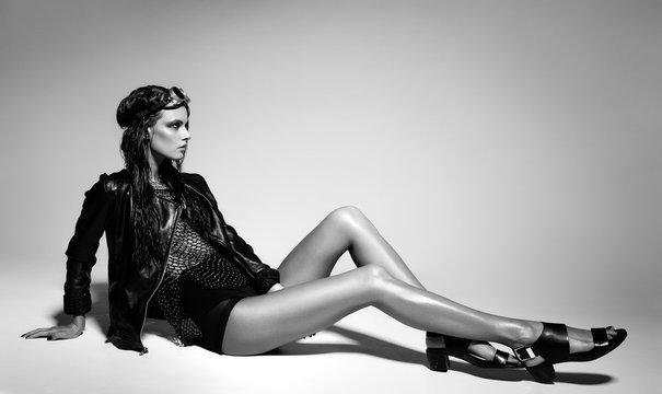 sexy woman model dressed punk, wet look, posing in the studio