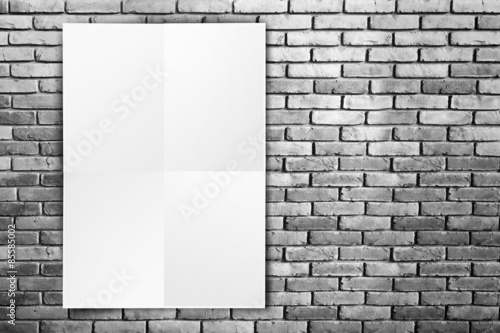 Black White paper poster hanging at grunge brick wall,Template m ...