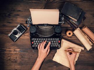 Retro typewriter on wooden planks