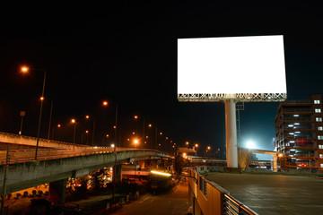 Blank billboard near express way at night for advertisement.