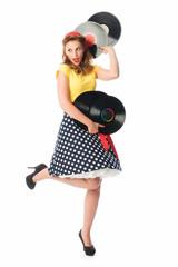 Pin up Girl hält Schallplatten und tanzt