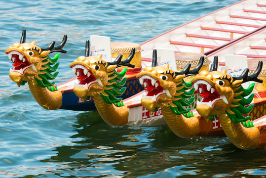 ABERDEEN,HONGKONG,JUNE 20 2015: Boats racing in the Love River for the Dragon Boat Festival in Aberdeen Hongkong