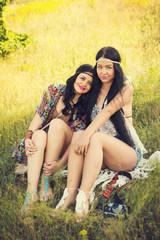 Bohemian fashion girls outdoors in summer