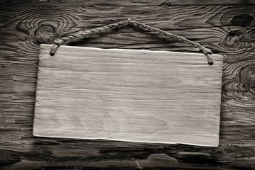 light wood signboard on dark wood