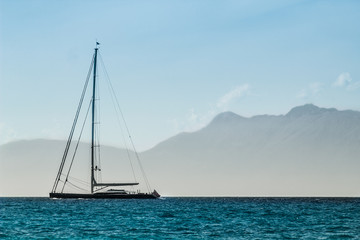 Sailboat floating on quiet sea